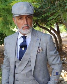 Gray wedding suit in elegant Prince of Wales with blue stripe. Peak lapels, ticket pocket and two rear openings. Grey Suit Wedding, Wedding Men, Mens Fashion Suits, Mens Suits, Style Costume Homme, Double Breasted Vest, Blue Suit Men, Italian Men, Gray Weddings