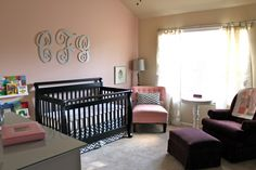 Grey Chevron crib skirt and throw pillow in a pink and purple nursery