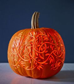 Here's a pro trick for creating a glowing 3-D effect on your pumpkin: Use a lemon zester, clay loop or linoleum cutter to carve into (but not through) the top layer of pumpkin skin. We guarantee this technique will make any design shine. Click through for a tutorial and more pumpkin carving ideas.
