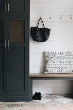 Kate Marker Interiors - Stoffer Photography - White and black pillows sit on a walnut bench top complementing a black bench fixed against white and gray dimaond pattern floor tiles and against a white shiplap wall fitted with brass hooks. Mudroom Cabinets, Mudroom Laundry Room, Black Bench, White Shiplap Wall, Black Pillows, Floor Patterns, Fun Patterns, Black Cabinets, Ship Lap Walls