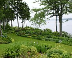 Landscaping Shaded Areas for Your Inspiration: Beach Style Landscape With Landscaping Shaded Areas And Lawn Pathway Also Mass Planting Decor Completed With Lake View ~ biawow.com Exterior Design Inspiration