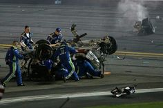 This is a pic of Dale Jr's crew coming to the aid of Austin Dillon after the crash at Daytona Speedway. July 5th, 2015. #3 #RCR `™`