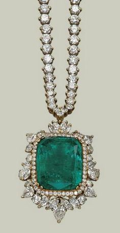 AN EMERALD AND DIAMOND NECKLACE The detachable pendant centering upon a cushion-shaped emerald within a circular-cut diamond frame and a pear-shaped, marquise- and brillant-cut diamond surround, to the graduated brillant-cut diamond line neckchain, mounted in gold, chain 41.0 cm by dena
