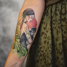 Woman with cat tattoo by Aga Yadou