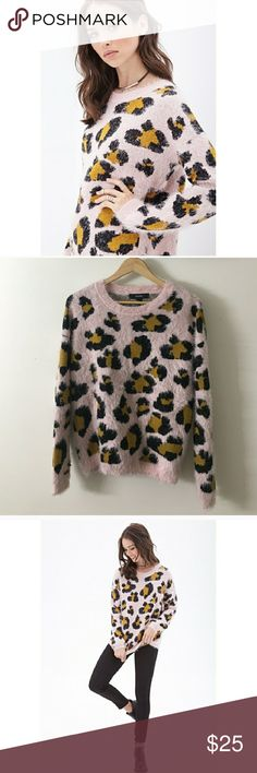 Pink fuzzy (not itchy) super soft leopard sweater EUC. Please let me know if you have any questions. I would be happy to help. I welcome all reasonable offers. Thank you for checking out my closet! Happy Poshing :) Forever 21 Sweaters