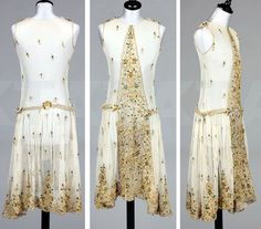Ivory tulle dress, ca. 1926, decorated with gold embroidery and beetle wings. Probably made from an Edwardian skirt panel. Kerry Taylor Auctions
