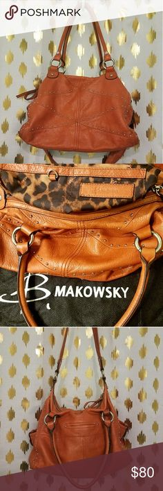 B Makowsky Shoulder Bag B Makowsky shoulder bag.  Orange leather cisscross studded with animal print interior. Outer pockets on both sides and secret pocket on back. Two pockets inside plus standard zipper pocket and key ring (pictured).  This bag looks and FEELS great.  Perfect color for fall. Pair it with a chunky sweater and leggings for a day at the office or coffe shop.  This bag comes complete with the orginal black storage bag! b. makowsky Bags Shoulder Bags