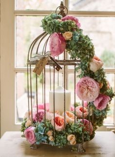 Vintage Birdcage wedding centrepiece, as featured in an article by 'Wedding Flowers and Accessories' Magazine.