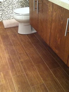 Wood-look ceramic tile - I have this in my house and I love it! Hmm maybe  an idea for