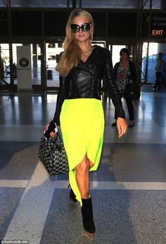 Hard to miss: Paris Hilton  definitely drew quite a few looks as she walked through the terminal at LAX airport on Friday