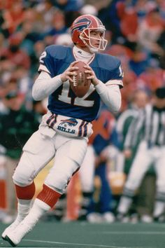 "Jim Kelly / Employing the ""K-Gun"" offense, known for its no-huddle shotgun formations, Kelly led one of the great NFL scoring juggernauts in the Buffalo Bills. Kelly led the Bills to four consecutive Super Bowls, from 1991 to 1994; however, each time the team lost. He was inducted into the Pro Football Hall of Fame in 2002 in his first year of eligibility.  Kelly holds the all-time NFL record for most yards gained per completion in a single game (44)."