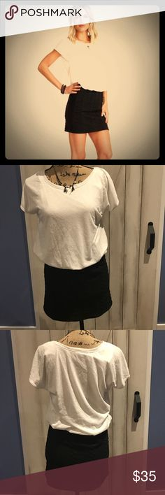 Dress This dress by Potters Pot looks like a tshirt and a skirt.  The black weave of the skirt gives some stretch and is comfortable to wear.  Is bodycon on the bottom.  New without tags. Dresses Mini