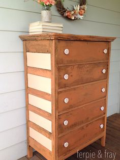 """Dresser by Ferpie and Fray painted in """"Pumpkin"""" from Old Fasioned Milk Paint Co. Side panels done with a custom mix of Pumpkin and """"Antique White"""" from General Finishes. Sealed with General Finishes Top Coat in Semi-Gloss."""