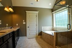 Granite Bathroom Countertop and Tub Surround Installation and Fabrication