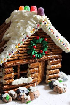 Cute idea ~ Decorated Pretzel Cabin ~ instead of the usual gingerbread & is faster too.