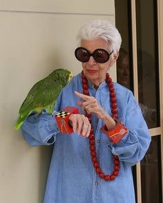 Love those cuffs and the necklace. And the parrot too, with Iris Apfel.