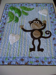Monkey Quilt for Baby, Toddler, Child with Appliqued Monkey in Blues, Green and Browns. $125.00, via Etsy..