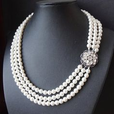 Hey, I found this really awesome Etsy listing at https://www.etsy.com/listing/66036048/multi-strand-pearl-bridal-necklace
