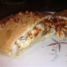 So quick to make and easy to personalise! Feel free to use bell pepper, mushrooms, olives, pepperoni, etc., homemade calzones so easy to make! Party Size Sausage Calzone Allrecipes.com