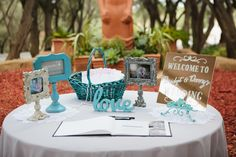 Square mirror welcome sign in a beautiful aqua table display. How creative is this?!