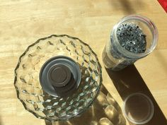 Pour crushed glass into a bowl for this crazy cool countertop trick