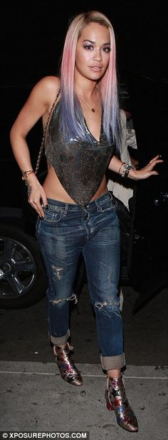 Racy:Rita flashed plenty of skin in a handkerchief top, with the star gushing about her retro '90s chain top' on her Instagram page before her night out