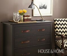 Replace plain metal knobs of a dresser with leather pulls attached by brass rivets.