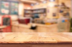 empty top of wooden table with blur coffee shop background