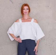 """Couture quality PDF sewing pattern. Versatile, off the  shoulder,loose-fitting, crop top. Cropped length with wide shoulder  straps. Sleeves fall on forearm.Perfect top for your next holiday. Dress it  up or down. Makes a great swimsuit cover-up!Two sizes: Small/Medium;  Large/Extra LargeFull Scale 36"""" (91.4 cm) wide layout. (See printing  instructions below).Level of Difficulty: AdvancedFabric Recommendations:  Light to medium weight higher quality linen.File includes pattern printing…"""