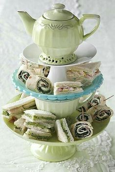 Three tiered teapot, teacup,  snack plate with tea sandwhiches