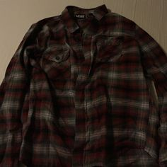 Vans Flannel Brand new! I wore it once and it's just been sitting in my closet. Men's size Small but fits me! Vans Tops Button Down Shirts