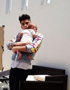 These Photos of One Direction With Babies Will Make Your Day