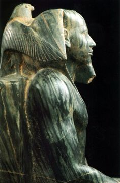 Life-sized statue (detail) of 4th dynasty pharaoh Khafre (in Greek, Chephren). Made of Egyptian gneiss (Chephren diorite), the falcon (Horus symbol) is shown as protector and guide. Enthroned ca.2520 BC, he reigned for about 26 years during the Old Kingdom. Son of Khufu, builder of the Great Pyramid, Khafre's pyramid stands next to it on the Giza Plateau