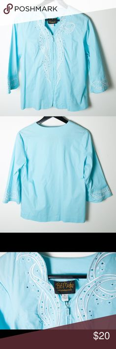 Bob Mackie Wearable Art Zip Up Blue Blouse Small Great preloved condition Bob Mackie Wearable Art blouse. Features white embroidered flowers and swirls on a light blue top. Matching design around the bottom of the sleeves. Bob Mackie Tops Blouses
