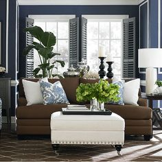 coastal living in brown and blue | Navy and White Living Room. Ottoman inspiration
