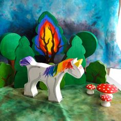 Unicorn Toadstools Trees . Love this bright and colourful simplicity. Wooden Toy - Wooden Rainbow Unicorn - Waldorf Toy. The Enchanted Cupboard via Etsy.
