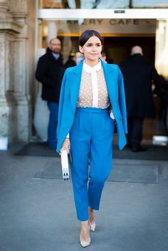 Miroslava Duma in a blue pantsuit & sheer lace top