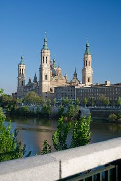 Basilica of Our Lady of the Pillar in city of Zaragoza, Aragon, Spain. Roman Catholic church, venerates Blessed Virgin Mary for her claimed appearance during start of Christianity in Spain. Predominately built between 1681-1872 with Baroque style architecture.