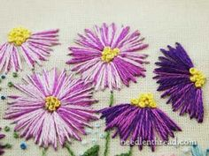 """""""Straight stitch can be quite effective! By fanning out straight stitches from a center point and making their outer edge a bit jagged, you can create a pretty nice embroidered flower."""""""