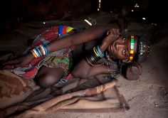 """Mucawana girl and her wood pillow - Angola_Eric Lafforgue_  """"This is the way Muhacaona protect their haircut made of cow dungs, mud, and herbs. Inside the house, very few things, no furnitures. A simple life in a remote area of the world, isolated by 40 years of civil war..."""""""