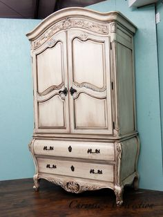 "French wardrobe/amoire. Multi layered, antiqued finish. Painted by Chrissie's Collection. Measures 49""x25"" and 85""t. $595."