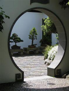 Moon gate in Portland's Chinese Garden. Photo by Taryn Koerker