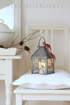 The simplicity of Christmas - lanterns and generous amounts of white and a touch of red.