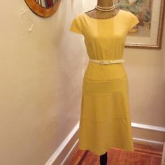 """Very Delicate Dress by Anne Klein  This wonderful soft summer delight. This dress has half cuff sleeves. Bust 38"""", wrist 34"""" and from wrist to hem 25"""". Soft yellow dress with white belt and top of dress lined with bra snaps. Vintage Dresses"""