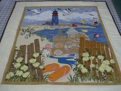 Embroidered beach tile scene