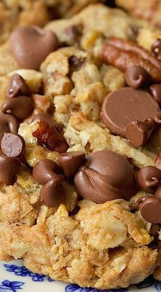 * Toffee Cowboy Cookies Could add more chocolate chips. An old classic treat with a few fun twists, these delicious Toffee Cowboy Cookies are loaded with chocolate chips, sweet toffee bits and crisp toasted pecans. Köstliche Desserts, Delicious Desserts, Dessert Recipes, Yummy Food, Pudding Recipes, Chocolate Chip Cookies, Chocolate Chips, Toffee Cookies, Candy Cookies