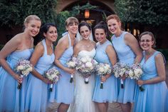 Bride & her bridesmaids, in a variety of sky blue dresses posing in the Villa Siena courtyard   Josh Snyder Photography   villasiena.cc