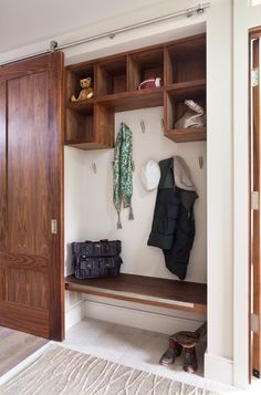 Contemporary Entry by Menendez Architects PC =- Sliding barn door hides it all!