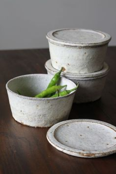 These ceramic pieces appear to be informed by contemporary mainstays of pyrex/tupperware. Textured glaze choice and stackable = very cool pieces.