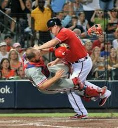This was scary to watch...thank goodness Chipper didn't hurt himself!  I'm glad Kratz wasn't hurt either, but man did I want him to drop that ball!
